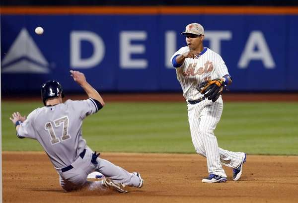 Ruben Tejada completes a double play after forcing