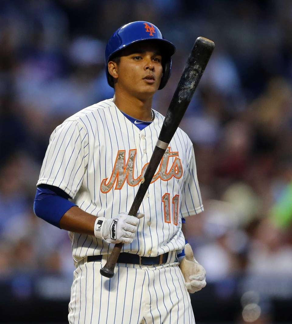 Ruben Tejada looks on during a game against