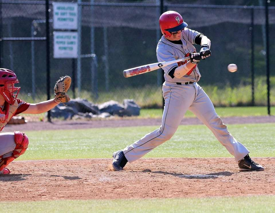 Plainedge's Dan Stock tries for a hit