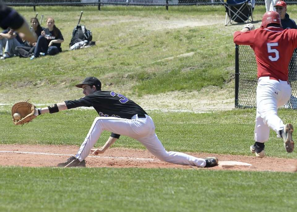 Sayville's Ryan Welch makes the grab at first
