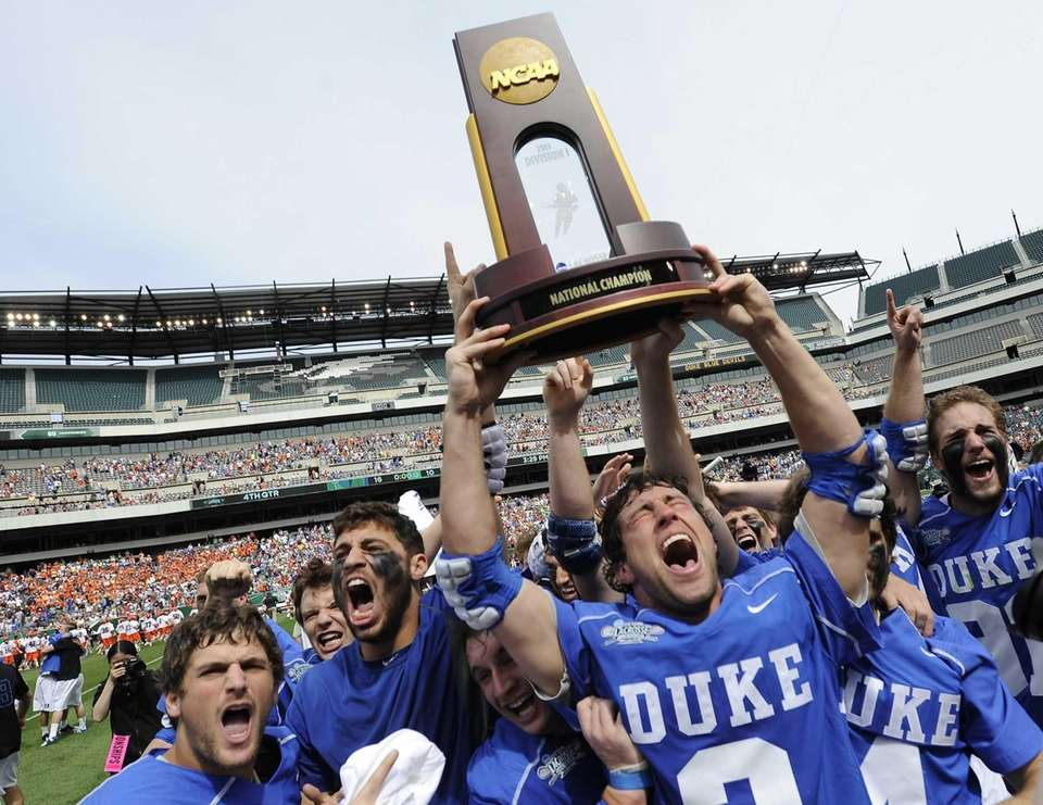 Duke's David Lawson holds up the NCAA college