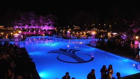 Guests dine and dance around the pool during