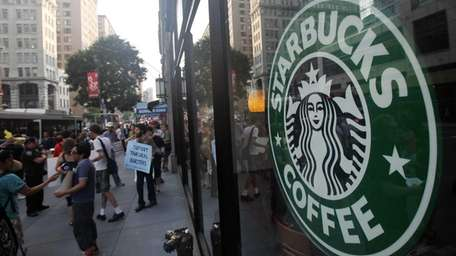 Starbucks baristas and supporters protest outside a Manhattan