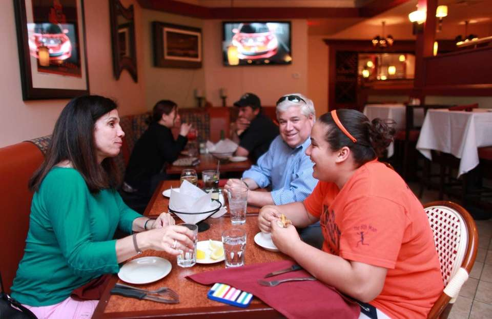 Patrons dine at Crave Restaurant and Bar in