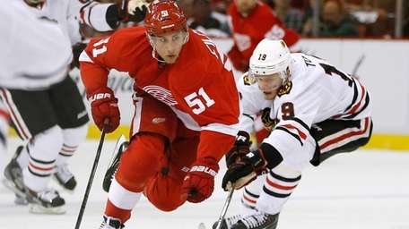 The Detroit Red Wings' Valtteri Filppula tries to