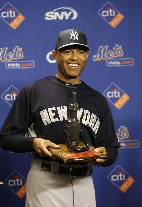 Yankees relief pitcher Mariano Rivera poses with a