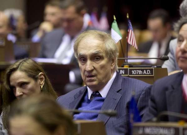 Assemblyman Vito Lopez sits during a session at