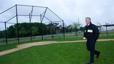 Islip Town Councilman Steven J. Flotteron walks across