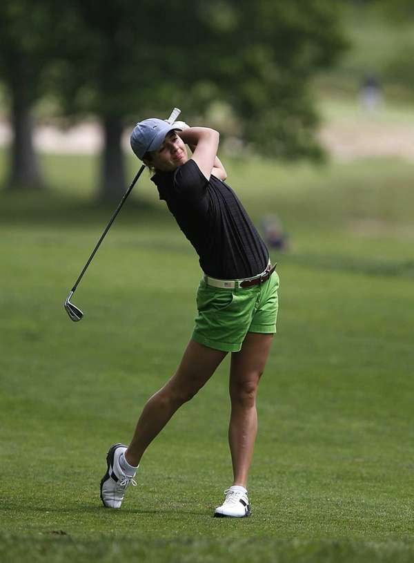 Garden City's Sam Sessa tees off at the