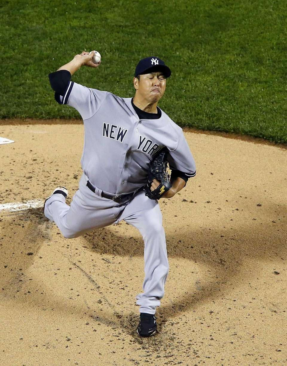 Hiroki Kuroda of the Yankees pitches in the