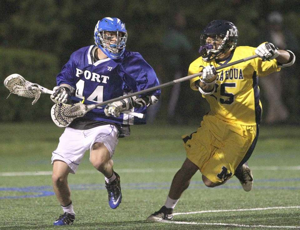 Luke Rizzo of port Washington tries to get