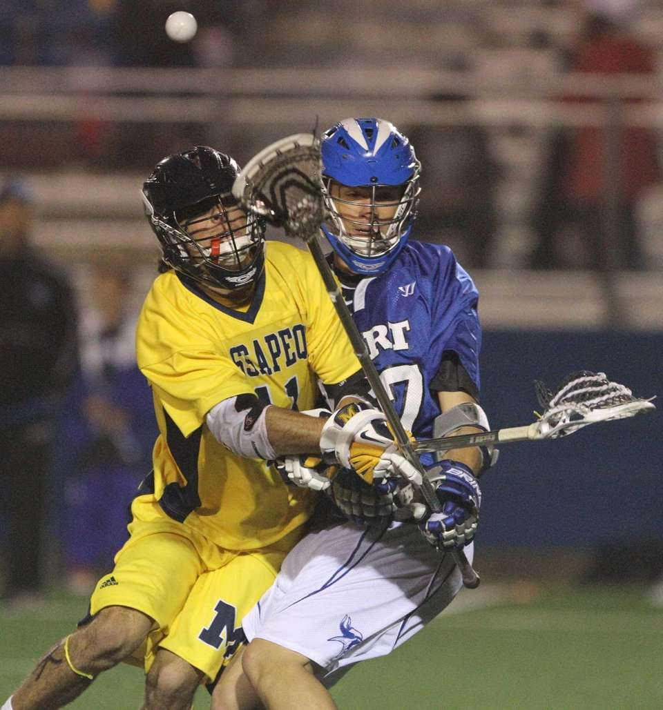 Craig Berge of Massapequa goes up for a