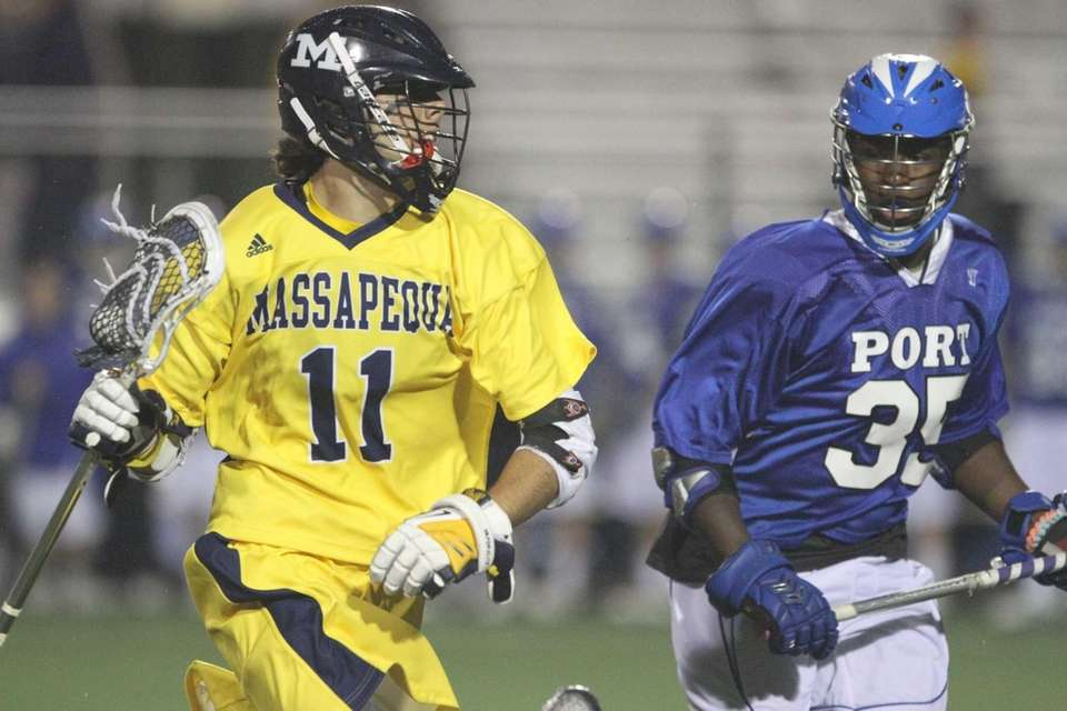Craig Berge of Massapequa goes up against Jermaine