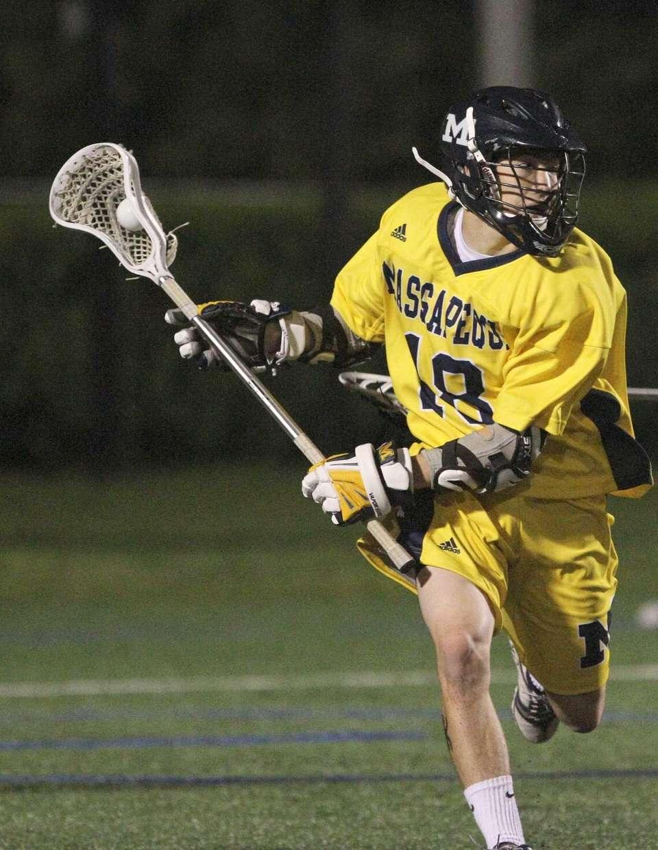 Carter Hawthorne of Massapequa brings the ball from