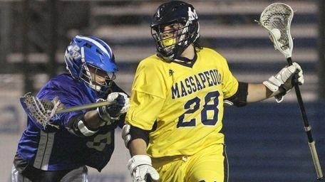 Paul Dilena of Massapequa gets by Jesse Kaplan