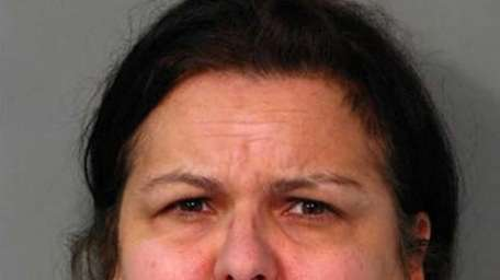 Donna King, 48, of Glen Cove, faces a