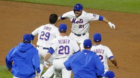 Lucas Duda of the Mets celebrates his game