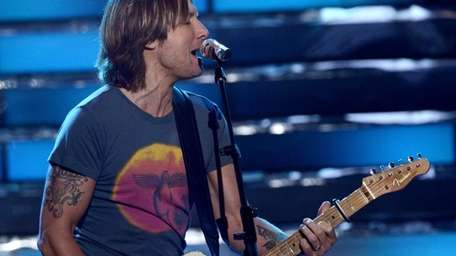 Judge Keith Urban performs onstage during Fox's