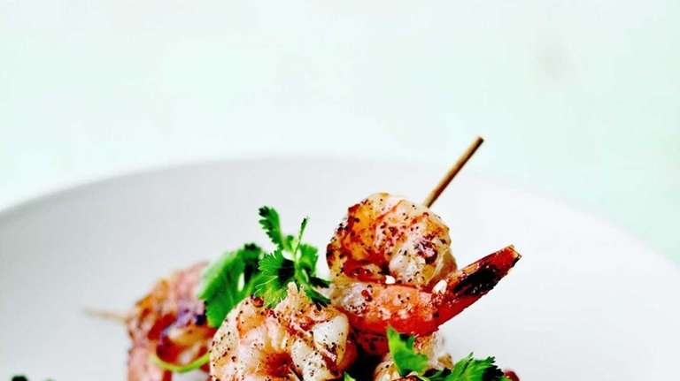 Grilled shrimp skewers with cilantro-mint chutney from