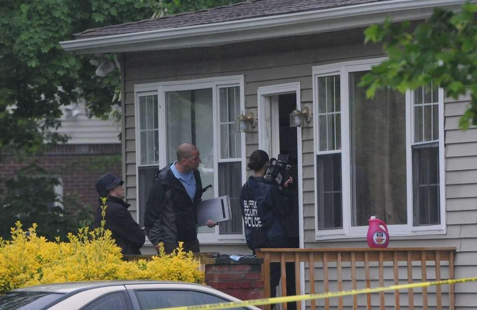 Investigators are in front of a home on