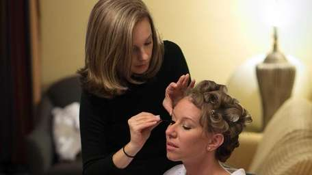 Mape-up artist, Sally Biondo applying makeup to bride