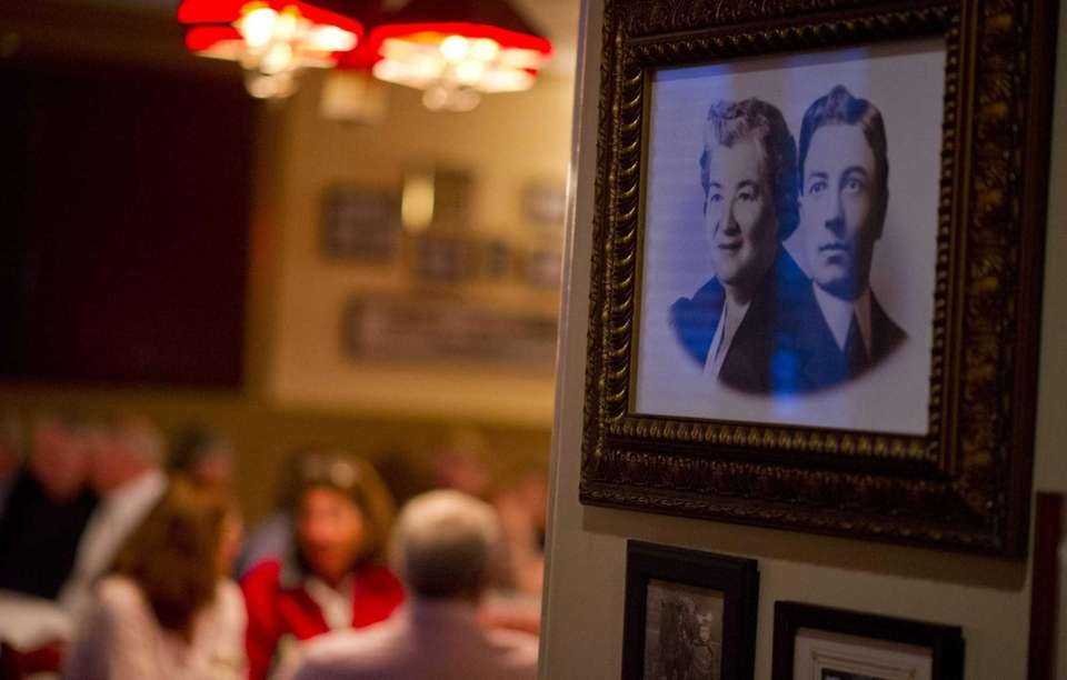 Family photographs line the walls at Stango's restaurant