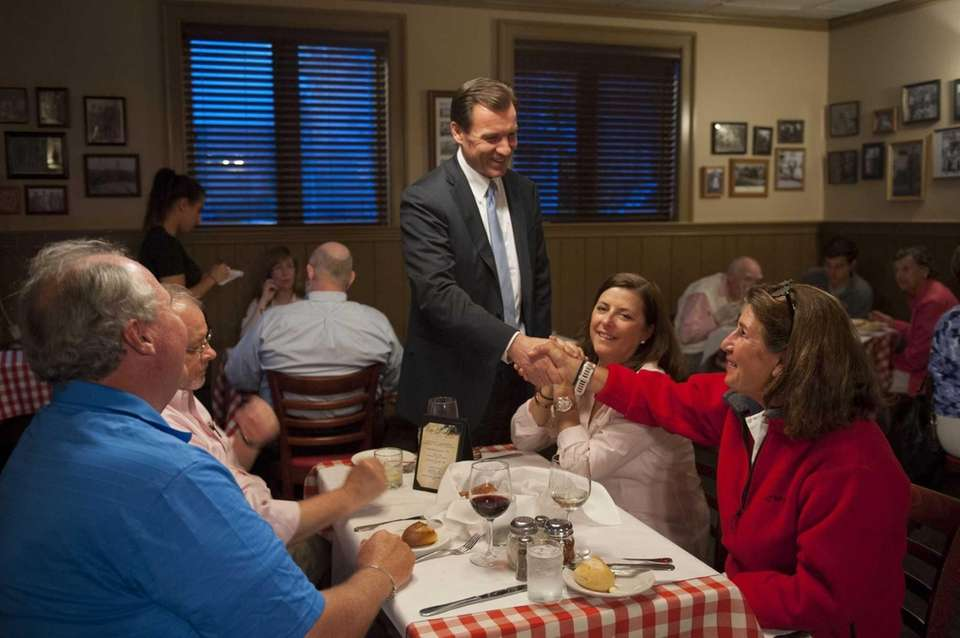 Tom Suozzi, center, at Stango's restaurant in Glen
