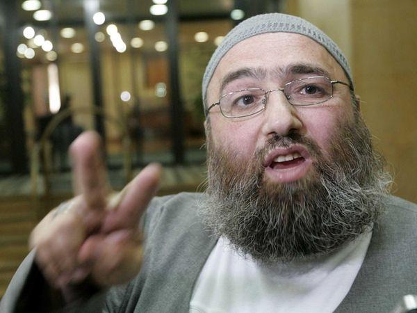 Muslim cleric Omar Bakri Mohammed gestures while talking