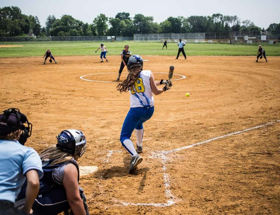 Kellenberg's Cristen Whigham hits a single against St.