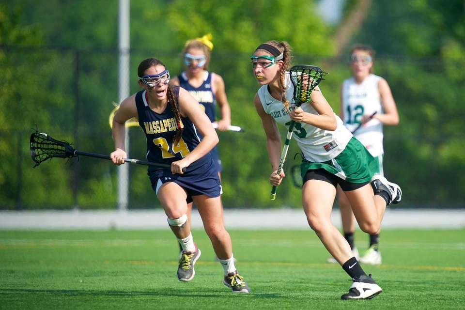Farmingdale midfielder Emily Marlow drives toward the goal