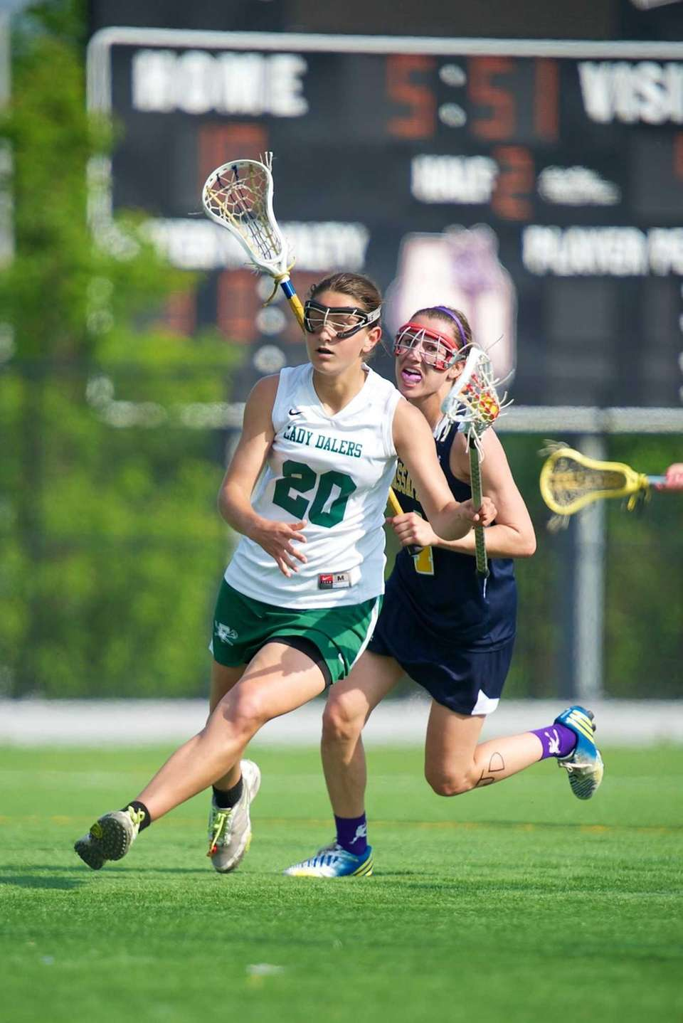 Farmingdale midfielder Nadine Hadnagy brings the ball up