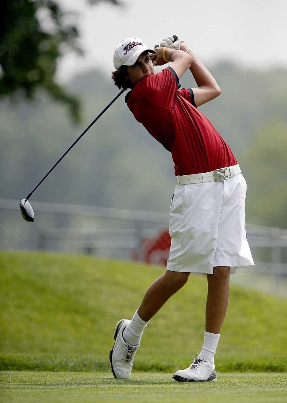 Smithtown East's Jack Truncale tees off on the