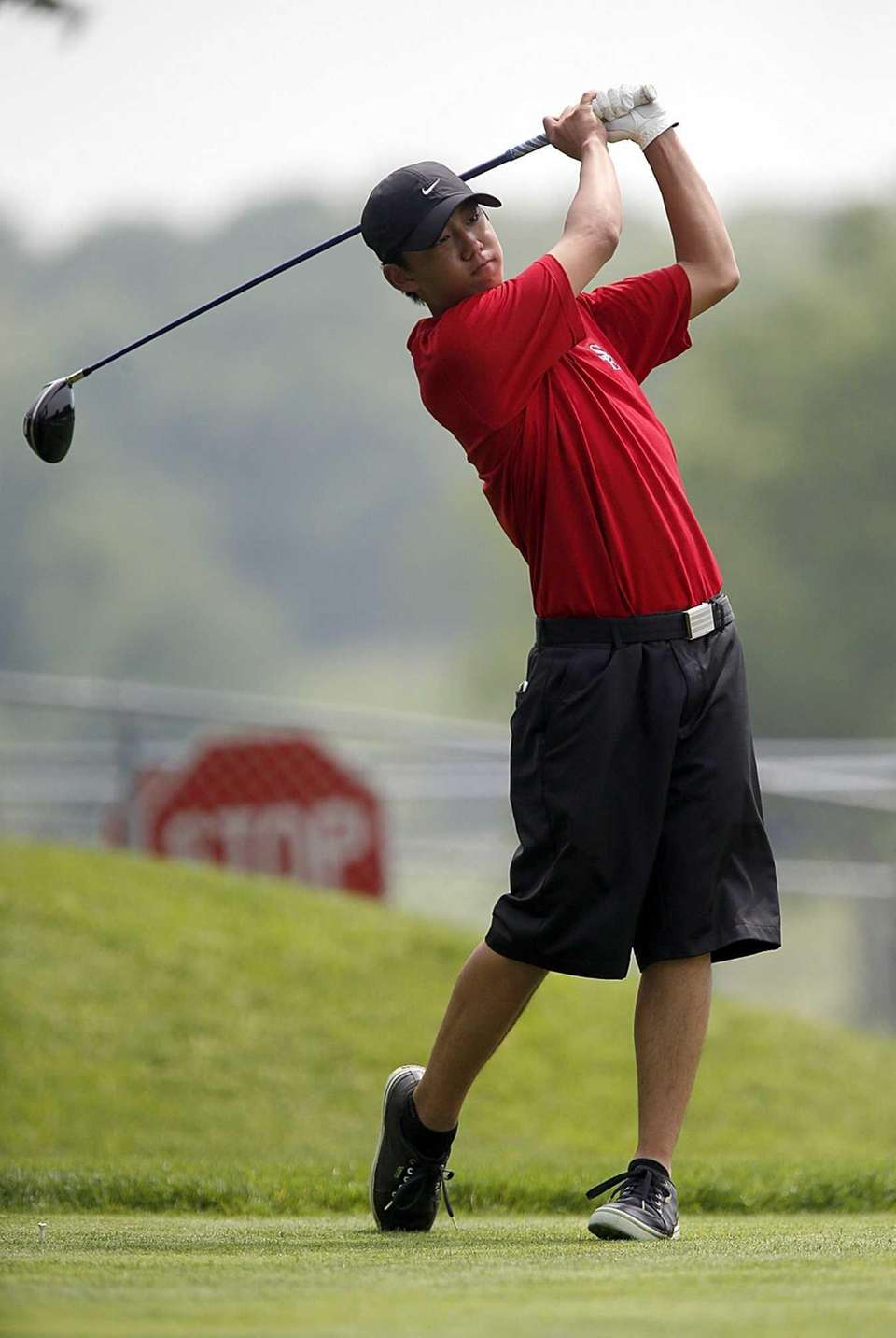 Smithtown East's Gilbert Chang tees off on the