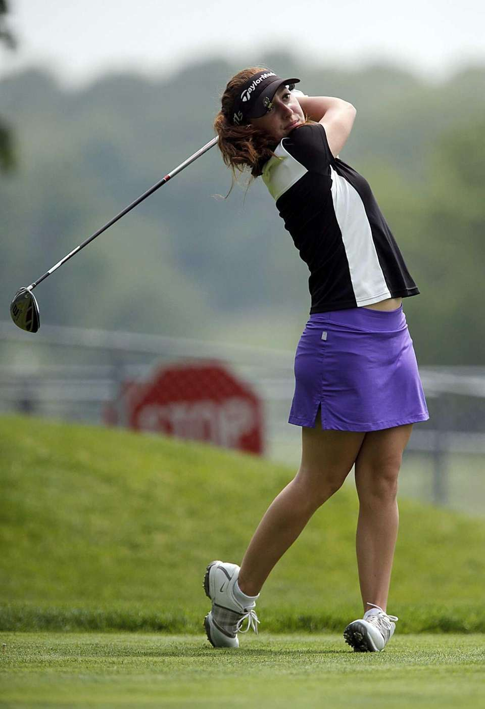 Farmingdale's Alix Lowe tees off on the fifteenth