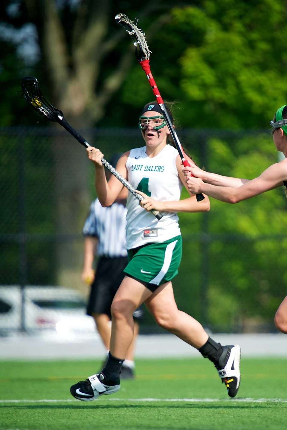 Farmingdale defender Samantha Brescia attempts to move the