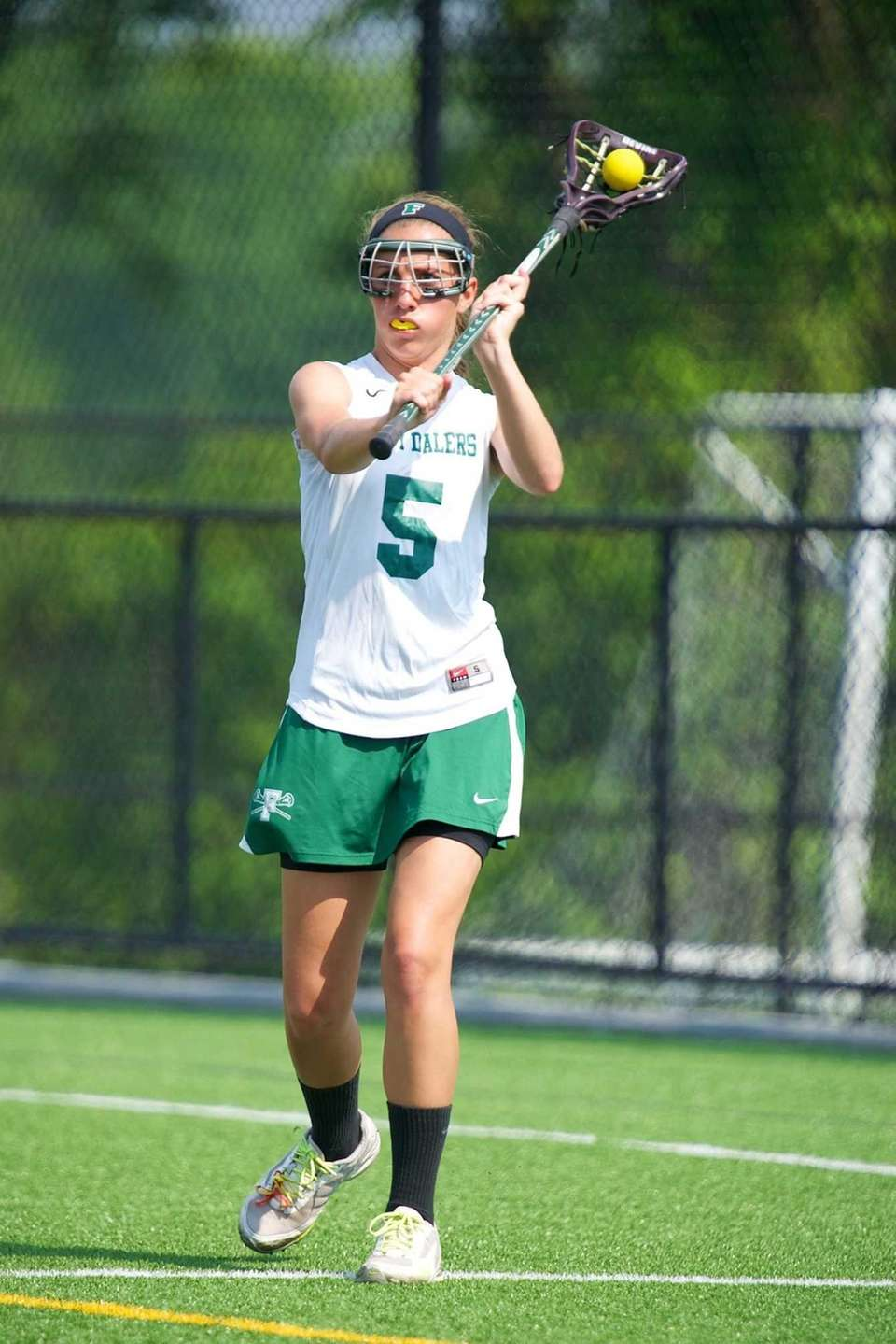 Farmingdale attacker Paige Devine handles the ball behind