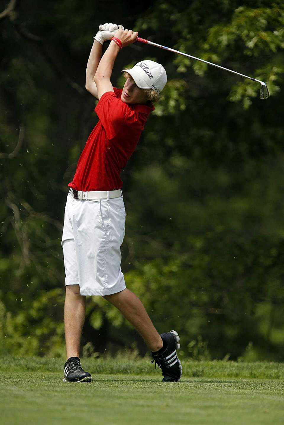 Smithtown East's Josh Leddy tees off the par-three
