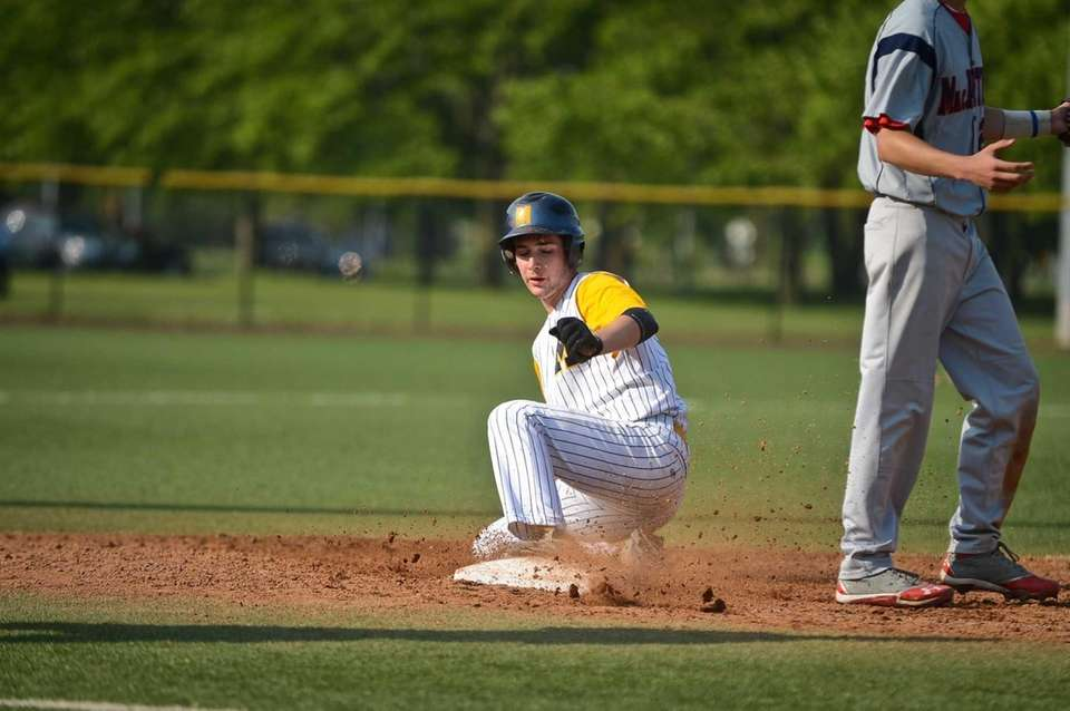 Massapequa senior Frank Portaro lands on third base