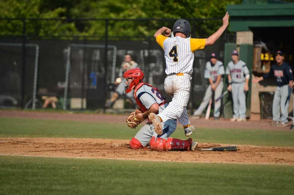 Massapequa junior Phil Michel lands on home base