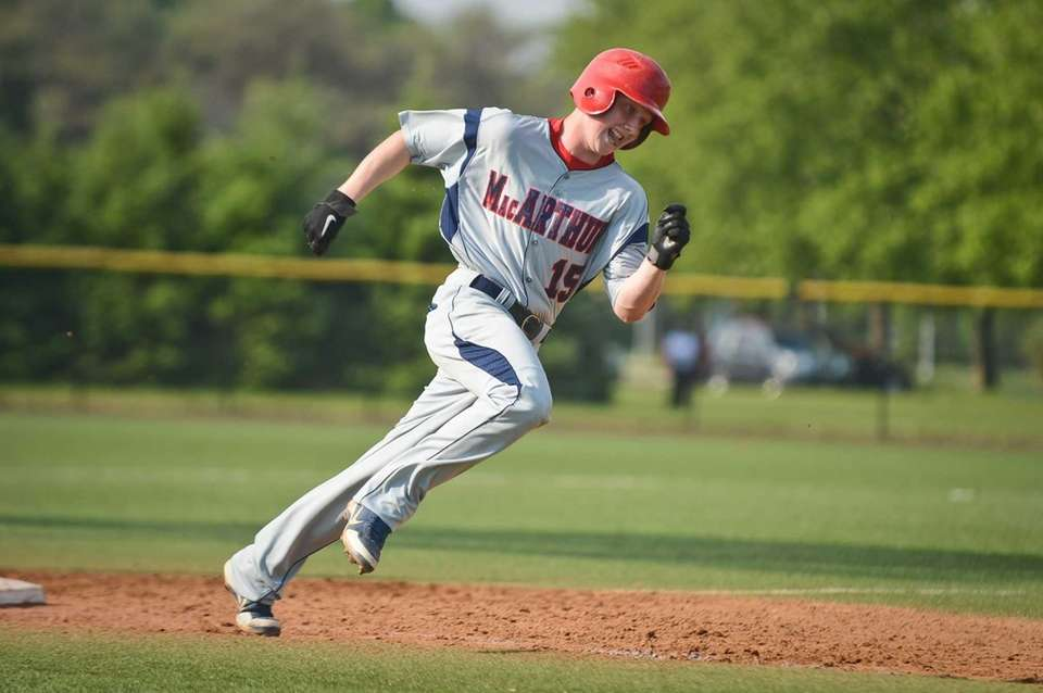 MacArthur junior James Knoebel rounds third base during