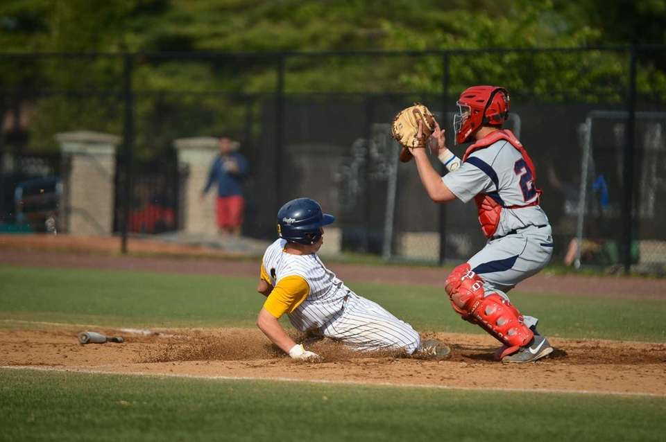 Massapequa senior Nick Comito lands on home base
