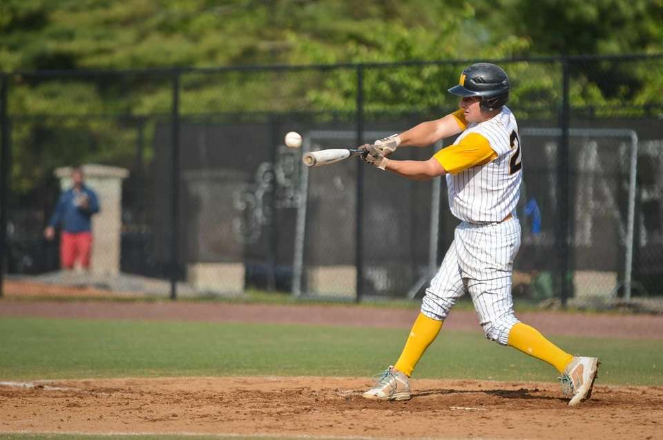 Massapequa senior Nick Fanneron hits the ball during