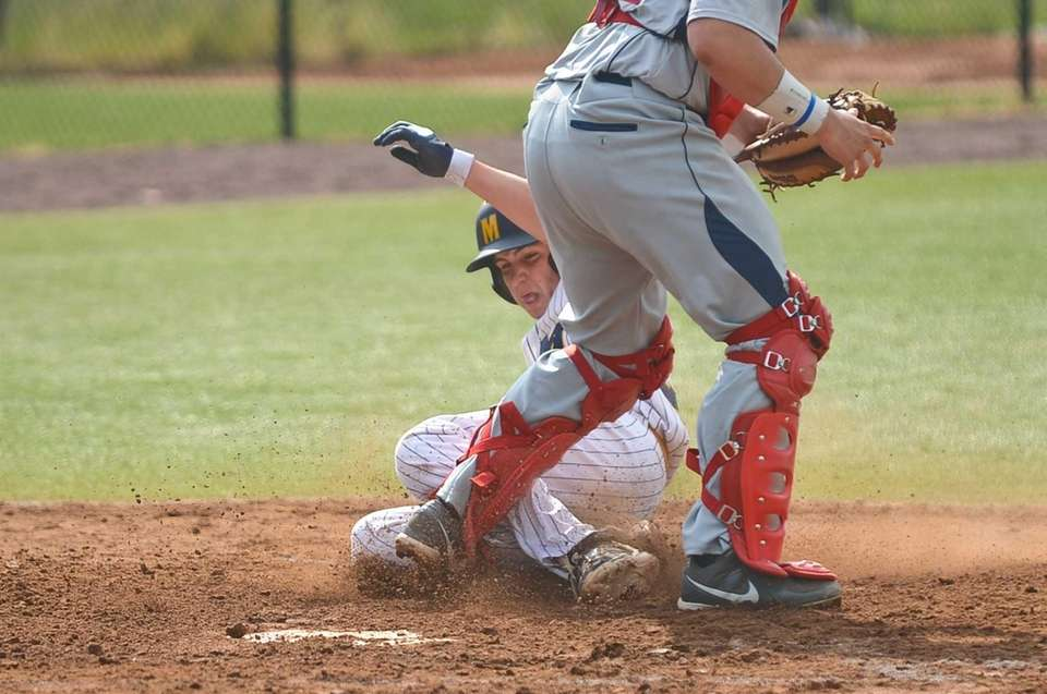 Massapequa junior Bobby Honeyman lands on home plate
