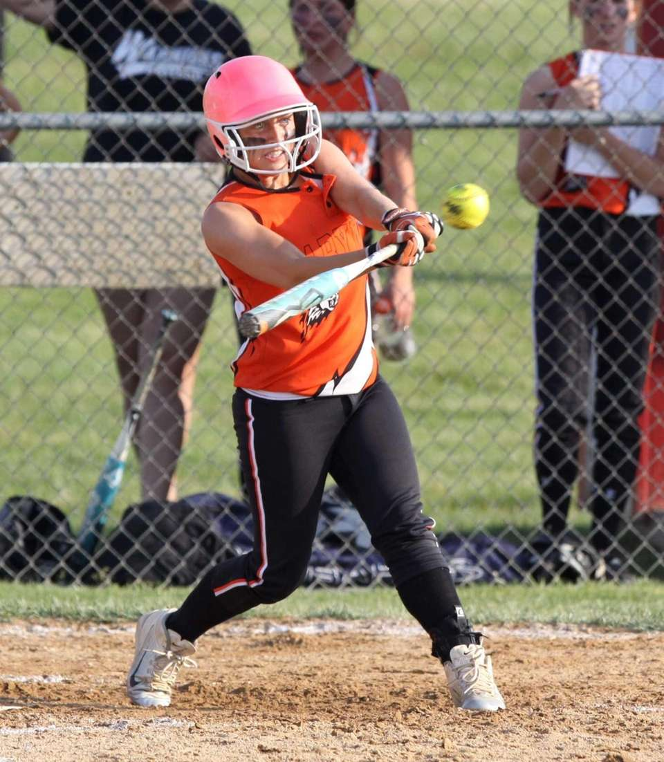 Babylon's Miranda Richards connects for a hit against