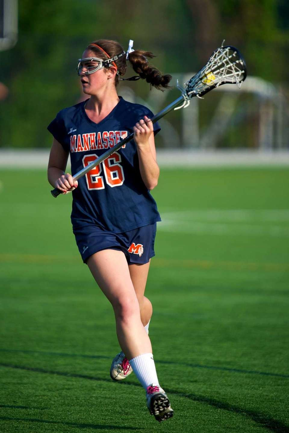 Manhasset midfielder Kellen D'Alleva carries the ball into