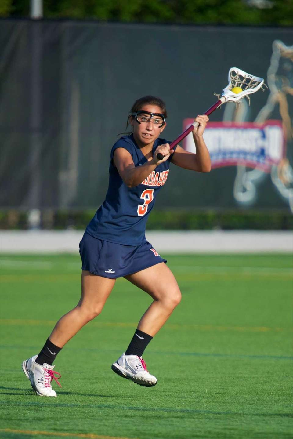 Manhasset Sarah Barcia passes the ball in a