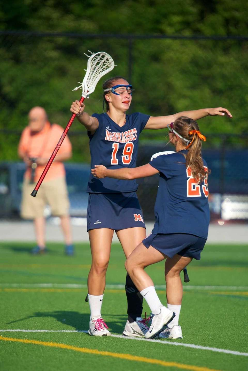 Manhasset's Kathryn Hallet celebrates with teammate Natalie Stefan.