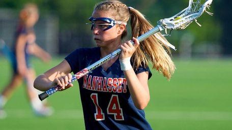 Manhasset attacker Sarah Phillips carries the ball up