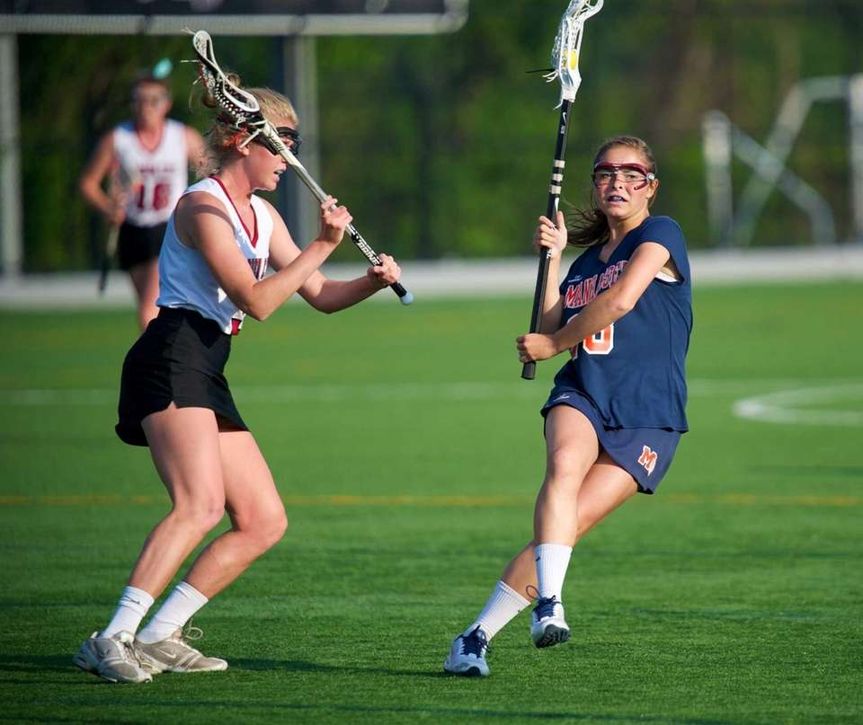 Manhasset midfielder Kathryn Hallet drives past the Garden