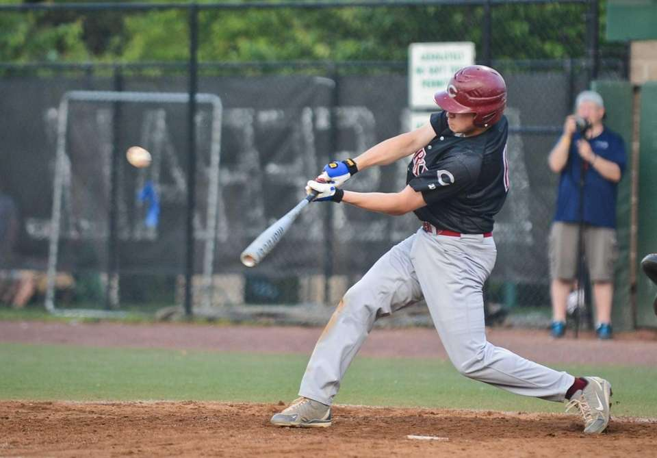 Clarke junior Mike Gismondi makes contact during the